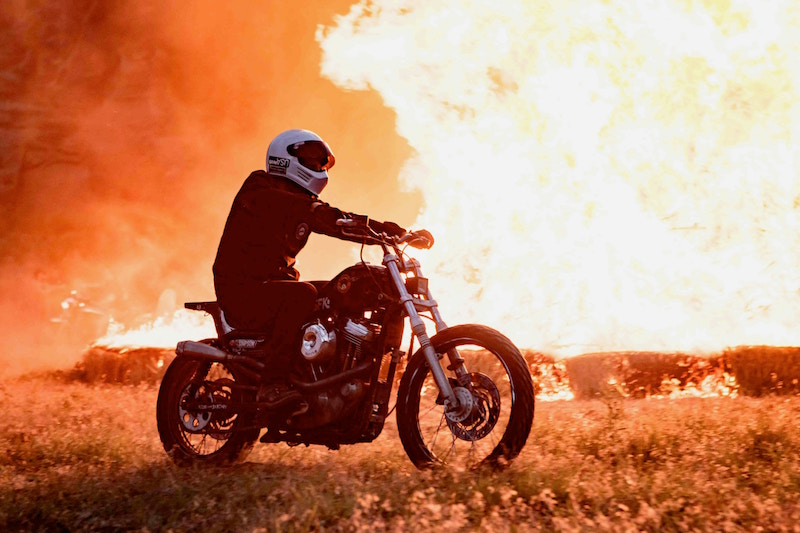 motorcycle riding past a fire