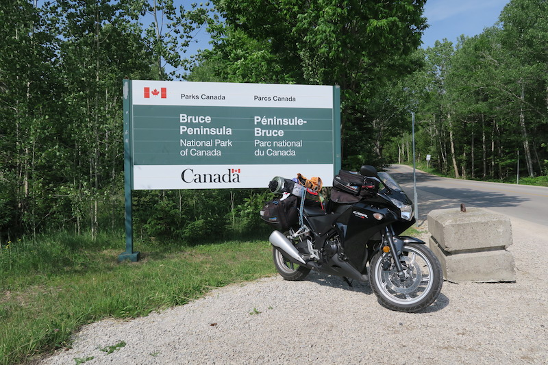 Taking Photos with my motorcycle at the Bruce Peninsula National Park entrance sign into the campground