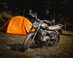 motorcycle camping with a tent and triumph bike