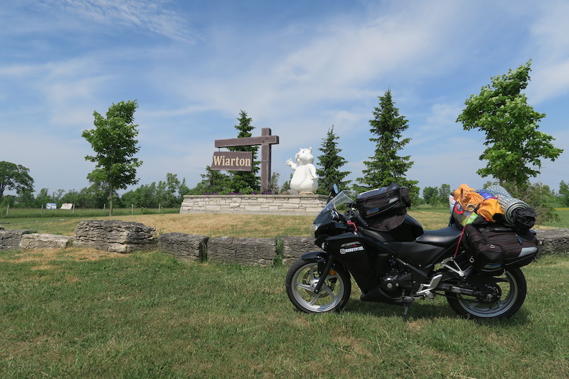 Stopping at the Wiarton sign as part of my Wiarton motorcycle cruise to Tobermory