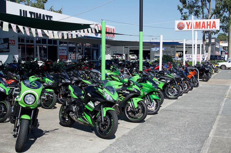 green yamaha bikes outside of the yamaha dealership