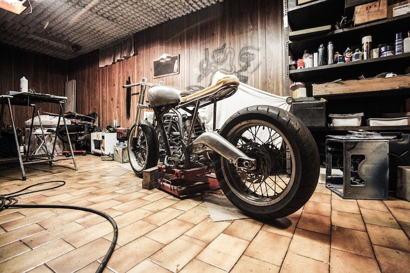 Old motorcycle being worked on in the garage