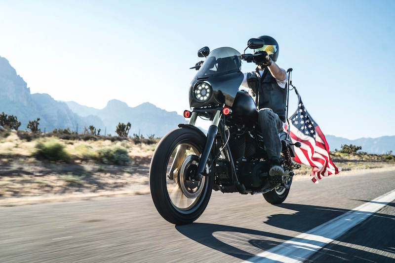 riding a harley davidson with american flag