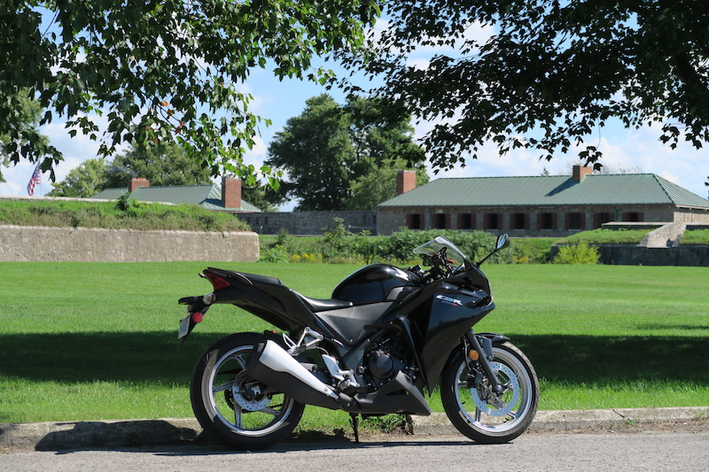 honda cbr250r parked out front of old fort erie