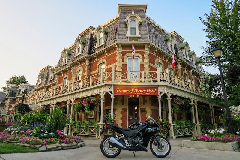 motorcycle parked out front of the prince of wales hotel in niagara on the lake