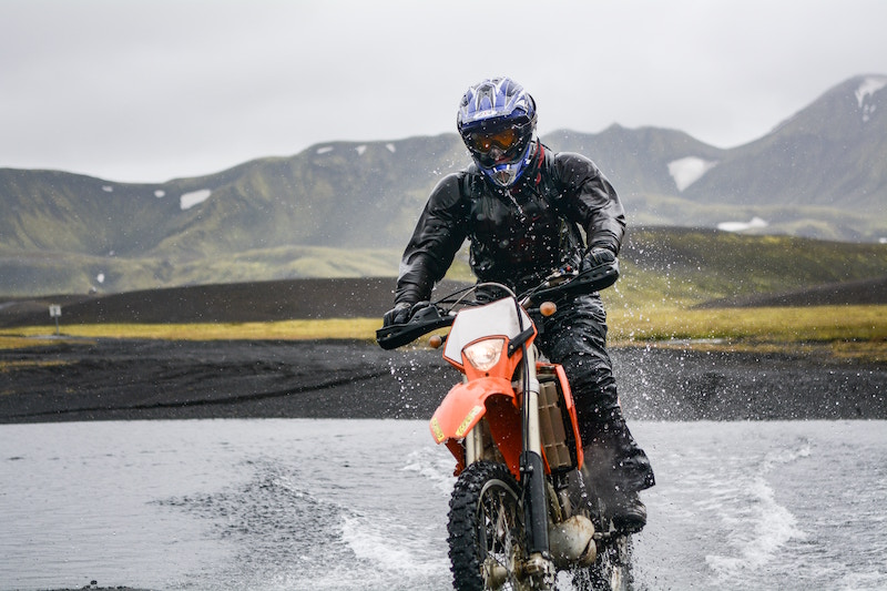 riding a dual sport bike through a river