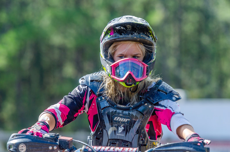 girl wearing dirt bike goggles
