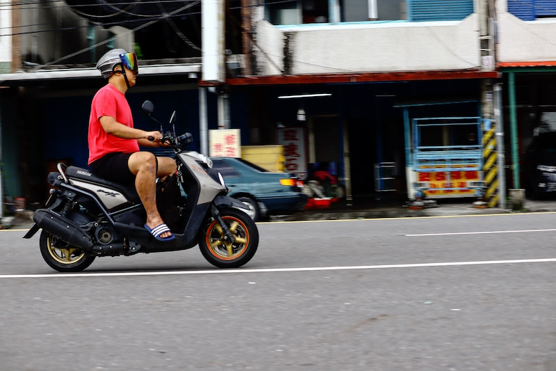 wearing goggles on scooter