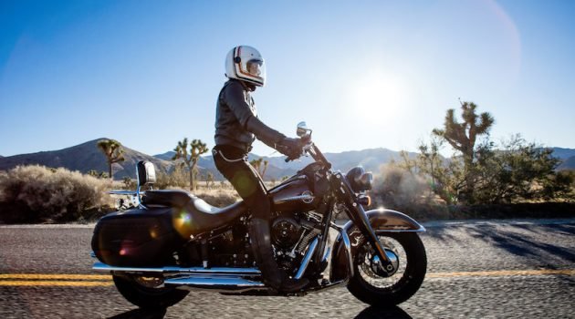 riding a harley davidson and standing up