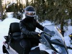 riding snowmobile outside in the winter